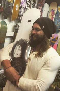 Jason Momoa Hugs a Skateboard With Lisa Bonet's Face on It, Naturally