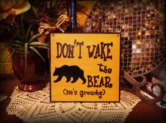 Don't Wake the Bear He's Grouchy. Measuring x 8 x 8 8 Painted in a light brown with Black trim and Black lettering. There's a tin bear painted black, bow and raffia to accent and a wire for easy hanging. Bear Signs, Bear Decor, Nursery Ideas, Wood Signs, All Things, Hand Painted, Lettering, Handmade, Painting