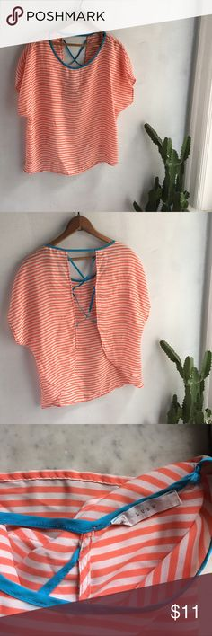 Cute Lush summer beach top Orange and teal top with a very showy and open back. Perfect beachwear. Polyester is easy to wash and drys quickly.size small. In nice condition with no stains or damage Lush Tops Tees - Short Sleeve