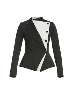 Black Textured Suiting double-breasted peplum jacket with White double lapel. Zipper detail at sleeve. Fully-Lined. Made in USA. Professional dry clean only.