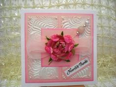 Card made with gorgeous Petaloo flower and embossed paper from The Paper Company.  Made the hat pin and glittered the flower.  Sentiment by JustRite Stamps.  Pearls by Mark Richards.