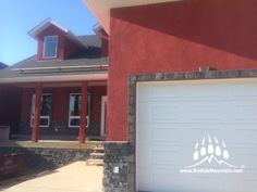 The owners of a new home in Cardston Alberta Canada used a Burgundy Master Wall Acrylic Stucco as the base for their home. They've accented the burgundy with our Rundle colored Thunderstone Natural Stone profile. Olsen Construction installed the Natural Stone. www.KodiakMountain.com