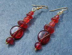 Crimson Glass Bead Earrings Wrapped with Gold Tone Wire on Etsy, $14.00