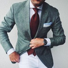 Make a dark green blazer and white chinos your outfit choice to look classy but not particularly formal. Shop this look on Lookastic: https://lookastic.com/men/looks/blazer-dress-shirt-chinos/20881 — White Dress Shirt — Burgundy Tie — White Pocket Square — Dark Green Blazer — Silver Watch — White Chinos
