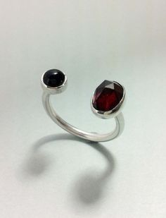 Double Ring set with Black Onyx & Garnet  Silver (925)  Hand-crafted  Size Small (British size L)  Dimensions: Band Width 1.80mm.  Gemstones: Onyx 5mm. Garnet 9x7mm.