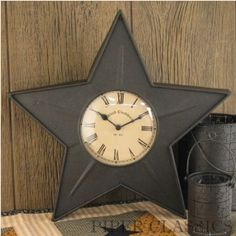 The star is a classic #country and #primitive icon - used for centuries as a decorative element.  Add a country primitive touch to any room in your home when our Black Star Clock is included in your decor. Textured black paint on metal.  Measures 16 high x 16.5 wide.