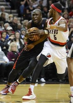 The Toronto Raptors' Mickael Pietrus (20) drives against Portland Trail Blazers' Will Barton (5) during the first half of an NBA basketball game in Portland, Ore., Monday, Dec. 10, 2012. (AP Photo/Greg Wahl-Stephens)