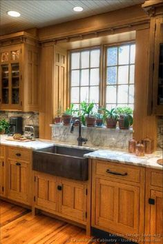 Beautiful cabinets with a copper apron sink-Crown Point cabinetry