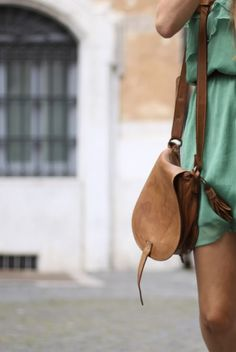 Small, satchel style cross-body in classic tan leather. Goes with everything. It looks so soft too.