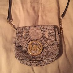 MICHAEL MICHAEL KORS Python cross body Great for going out or just an accessory to any outfit! It has a gold chain detailing on the strap as well as an outside pocket. MICHAEL Michael Kors Bags Crossbody Bags