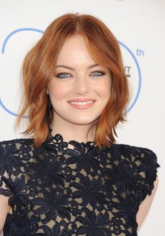 Play up the variations in your hair color by adding face-framing and choppy layers to your hair like Emma Stone.  - GoodHousekeeping.com