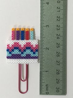 This Birthday Cake Planner clip or magnet is a fun and festive way to celebrate your birthday! Check us out for lots of fun planner ideas and planner accessories. Also tons of handmade perler bead creations. #happyheartspaperco #plannerclips #planneraccesories #planneraddict #plannercommunity #plannerlife #plannerlove #plannergirl #perlerbeads #partyfavors #birthdaypartyideas