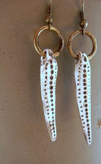 saraccino: Just like carved bone... I know I am way behind with the aje earring challenge at the moment. I made a lot of earrings but I just don't find the time and nerves to take pictures (my camera is not really working nymore, I need a new one). So hopefully I will have a new soon and show you all my earrings :) The beads are made with polymer clay and acrylic colours by me.