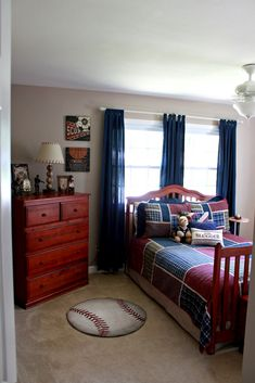 Vintage Baseball Boys' Bedroom. Like her use of neutral bedding and curtains. All you need to do to change the theme is change the accessories.