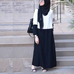 White blouse with black skirt and black top hijab