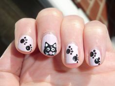 Pretty Black And White KItty Inspired Nail Art Design