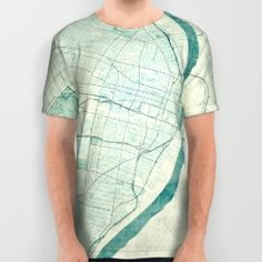City Art Posters Store. These premium quality American Apparel all over print shirts feature original art from seam to seam. The cotton-soft 100% polyester wicks moisture and maintains a rich color throughout.  All over print tees are unisex fit, so women should make size selections accordingly...