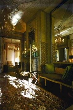 """The drawing room at """"Cow Hollow"""" painted with faux marble panels in fantasy colours by Elizabeth Duquette and Art Fine.  Even the real marble fireplace has been marbleised because it was the wrong colour."""
