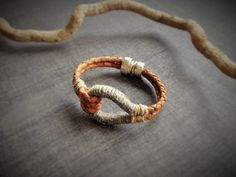 Items similar to Tan Leather knot bracelet wrapped with hemp, Natural statement bracelet with silver plated magnetic clasp, Braided leather cord bracelet on Etsy Leather Cord Bracelets, Leather Necklace, Braided Leather, Tan Leather, Knots, Pendant, Silver, Jewels, Handmade