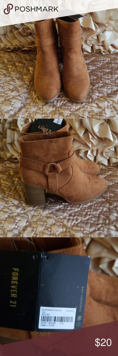 Carmel rust colored ankle boots New rust colored ankle boots, zip sides decorative side with gold color circle that attaches straps around, 3 inch heel Forever 21 Shoes Ankle Boots & Booties