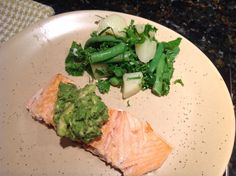 Pan seared salmon with homemade #pestamole and salad of @RootsandShootsFarm kale, green beans and onions, with potatoes.
