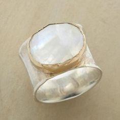 Our moonstone, 14kt gold and sterling ring exudes a graceful serenity.