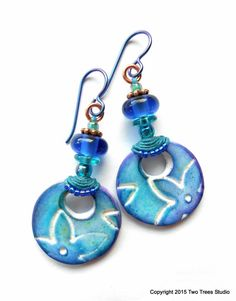 Blue Lilies: Beautiful ultra-lightweight floral earrings with a touch of the tribal. By Two Trees Studio.