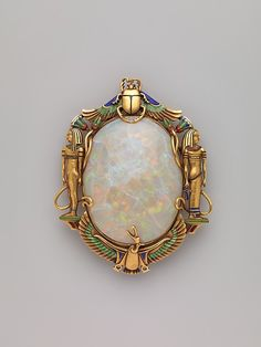 Egyptian Revival stylized brooch, Designed with gold, opal and enamel. American - Marcus and Company - NYC, (active: 1892 - ~ {cwlyons} ~ (Image/Collection: The Met Museum) Old Jewelry, Jewelry Art, Antique Jewelry, Jewelry Accessories, Vintage Jewelry, Fine Jewelry, Fashion Jewelry, Jewelry Design, Vintage Brooches
