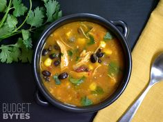 This Chicken & Pumpkin soup has a southwest flavor with smokey chipotle peppers, black beans, corn, and fresh cilantro. Step by step photos.