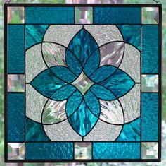 Aqua Blue Stained Glass Starburst Design Beveled Panel. $125.00, via Etsy.