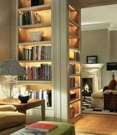 Three-sided bookcase. It would be wonderful if the middle shelf was a hidden door that led to downstairs!