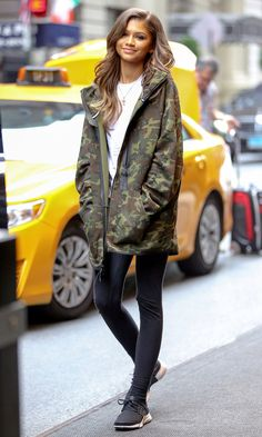 Fall Outfit Ideas: What to Wear With Leggings - Zendaya in leggings, black sneakers and a camo jacket