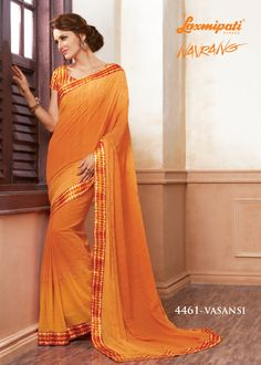 Look Royal with Our Orange Georgette Embroidery Saree and Satin Silk Red & Orange Blouse along with Satin Silk Printed Lace Border from Laxmipati.com. Limited stock! 100% Genuine Products! #Catalogue #Navrang #Design Number: 4461 #Price - Rs. 2625.00  #Bridal #ReadyToWear #Wedding #Apparel #Art #Autumn #Black #Border #MakeInIndia #CasualSarees #Clothing #ColoursOfIndia #Couture #Designer #Designersarees #Dress #Dubaifashion #Ecomme Laxmipati Sarees, Embroidery Saree, Dubai Fashion, Daily Wear, Silk Satin, Bridal Collection, Casual Wear, Print Design, Ready To Wear