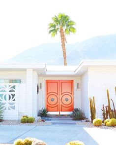 Love the everything about the entryway of this Mid-Century Modern home