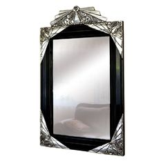 Stunning carved 1930's French mirror with Ebony black and silver leaf