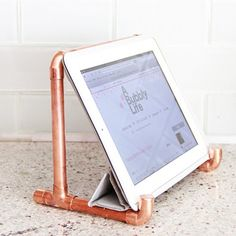 Copper tablet holder makes a great stand for any room in the house! I love it in…