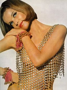 cat eyeliner + shiny coral lips + blush | Veruschka by Irving Penn, 1965.