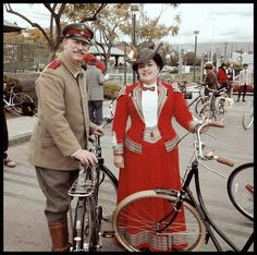 """Corseted and ready for a spin on  our reproduction 1888 """"Safety Bicycles"""" at LA Tweed Ride 2015. Red wool and silk cycling suit was made here at Lily Absinthe."""
