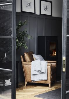 Walls painted in Smoke by Neptune Caspar tan leather armchair. Walls painted in Smoke by Neptune My Living Room, Living Room Chairs, Home And Living, Living Room Decor, Dark Walls Living Room, Dark Grey Rooms, Dining Chairs, Corporate Office Design, Tan Leather Armchair