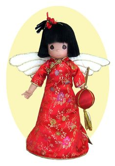 """Jing Wei"" (meaning ""Little Bird"") is a Chinese Treetop angel made by the Precious Moments Doll Company EXCLUSIVELY for Mandy's Moon!  This beautiful treetopper is 12"" tall.  She is dressed in a gorgeous red & gold silk embroidered dress and holds a lantern. Her face and hands are made of vinyl just like the Precious Moments dolls, (so she isn't breakable!!!) and she has realistic type hair.  She is a gorgeous addition to any Christmas tree, or she can be used freestanding year round"
