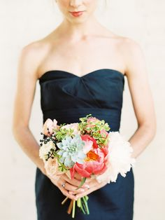 A beautiful bridesmaids look; navy dresses with fresh green, mint, white and coral bouquets and matching coral red