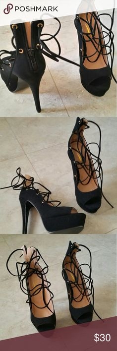 Black suede lace up heels *Material is Suede ,Leatherette  body and laces *Zips on back  *Heel Height: 6.5 inch *Shaft Height:8inch  *Platform Height:3inch *Opening :8 inch  Pair off with skinny jeans or leggings with a matching blazer:)  Open toe will model on request :)  NO BOX WILL PREPACKAGE BEAUTIFULLY * DECENT OFFERS WELCOME *   Any questions please feel free ?  Although they do not fit  Brandnew! Mint condition!  I wish these would fit me  Smoke / pet free home  Bundle to save more…