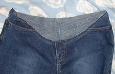 DIY Maternity jeans. I just did this to a pair of my jeans, except I use the top off of a pair of yoga pants, and they fit perfect. I will definatly be doing this to some shorts and capris for the spring/summer since the baby is'nt due until June 30th.