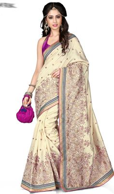 Appear stunningly engaging in this cream color embroidered kanchi silk sari. The attractive lace and resham work through saree is awe-inspiring. Upon request we can make round front/back neck and short 6 inches sleeves regular saree blouse also. #StunningLookCreamColorSari