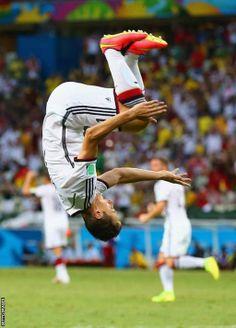 Miroslav Klose of Germany does a flip in celebration