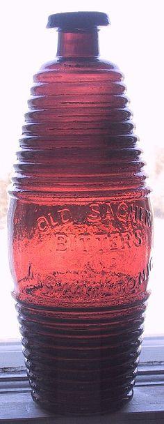 Raspberry puce Old Sachem Bitters and Wigwam Tonic