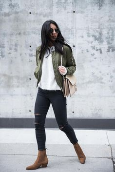 Kayla Seah looks cute and casual in this cropped khaki bomber, worn with suede Chelsea boots and distressed black denim jeans. This look is perfect for hitting the streets & everyday wear. Bomber: Topshop, Sweater: Mage, Jeans: J Brand, Boots: Sandro, Bag: Chloe.