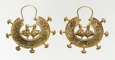 Earrings, 11th–12th century Greater Iran Gold wire and filigree  Diam. 2 3/8 in. (6.1 cm) Purchase, Friends of Islamic Art Gifts and Harvey and Elizabeth Plotnick Gift, 2006 (2006.273a,b)