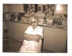 Vintage Photograph Woman Wearing Sunglasses Sitting in Old Time Retro Kitchen