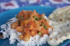 Chickpeas, cauliflower, and veggies in an Indian sauce over rice.